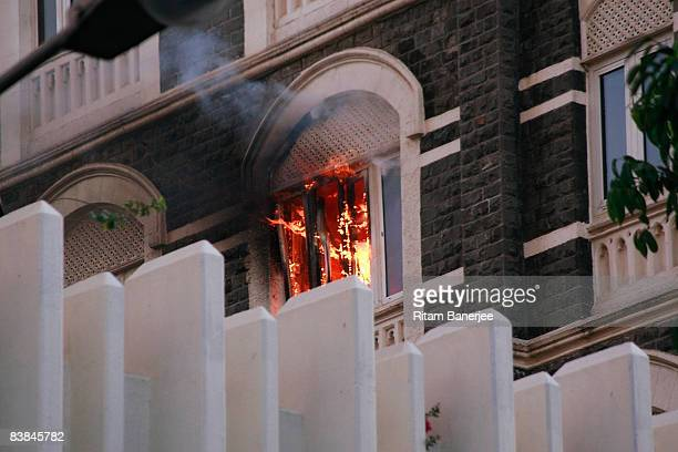 A fire breaks out in the Taj Mahal Palace Hotel on November 27 2008 in Mumbai India The city of Mumbai was rocked by multiple coordinated terrorist...