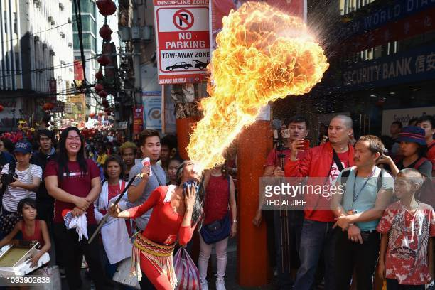 TOPSHOT A fire breather performs during celebrations for the Lunar New Year of the Pig in Manila's Chinatown district on February 5 2019