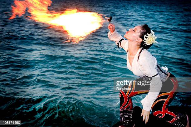 Fire Breather Standing Over Water