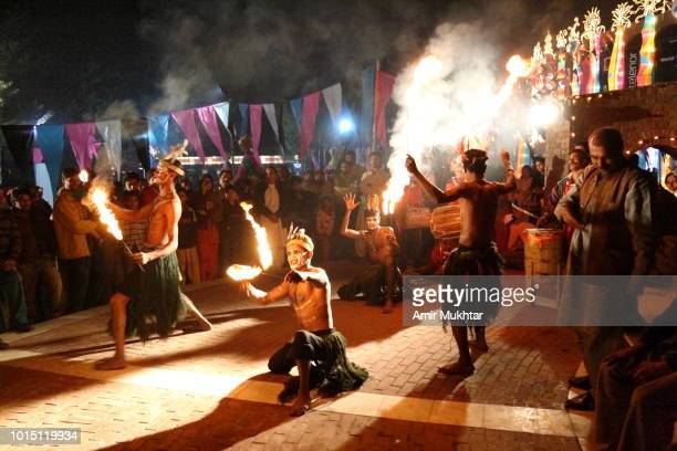 Fire breathers performing in the streets