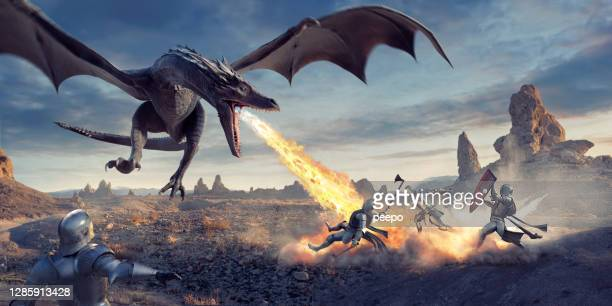 fire breathing dragon flying low and attacking knights in desert - non urban scene stock pictures, royalty-free photos & images