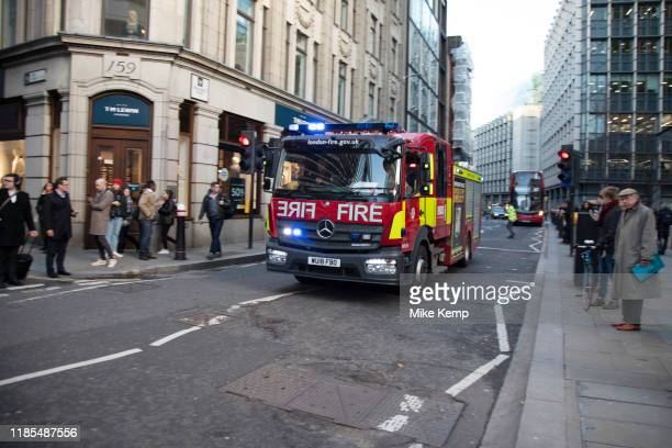 Fire brigade arrive as the City of London is locked down by Metropolitan and City Police following what is believed to have been a terror-related...