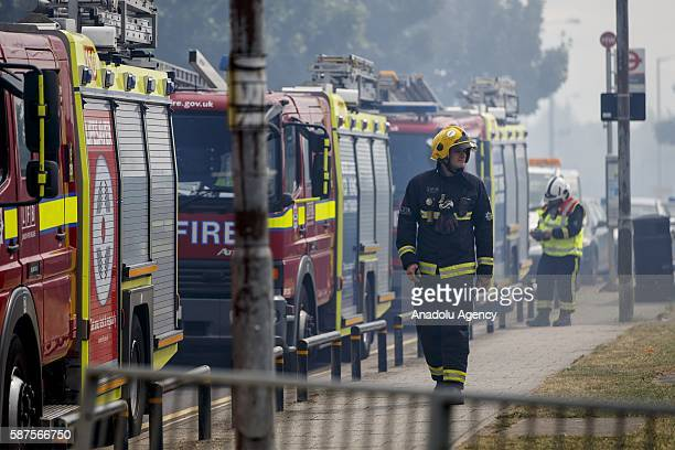 Fire brigade crew try to extinguish the fire after the fire disaster at London nightclub 'Studio 338' in North Greenwich London England on August 08...