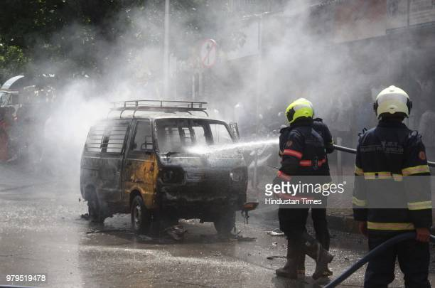 A van driver after his private van ferrying six children caught fire near Elphinstone Road Station on June 19 2018 in Mumbai India The six children...