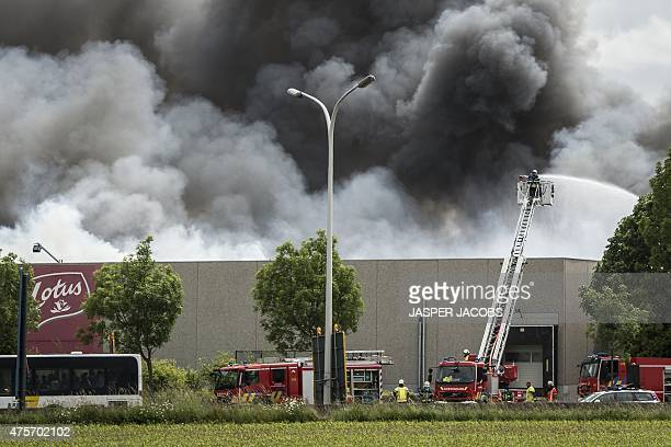 Fire Brigade extinguishes a factory fire at the Lotus Bakeries biscuit factory in Wolvertem Meise on June 3 2015 AFP PHOTO / BELGA PHOTO / JASPER...