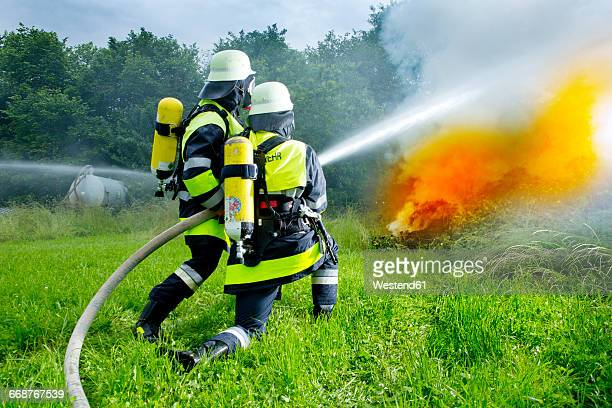 Fire brigade extinguishing fire