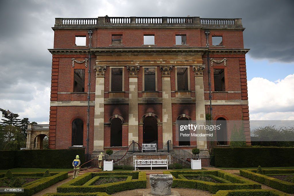 Fire brigade officers inspect the burned remains at Clandon Park House on April 30, 2015 near Guildford, England. Salvage operations have begun to rescue antiques from the remains of the 18th century stately home after a fire gutted large parts of the building.