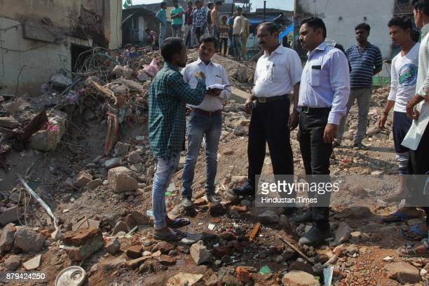 Fire brigade officials inspect a day after building collapse at Nai Basti Bhiwandi on November 25 2017 in Mumbai India Three people were killed and...