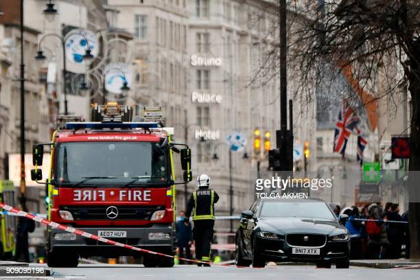 Fire brigade personnel work at the scene of a gas leak on the Strand in central London on January 23, 2018. Almost 1,500 people were evacuated from a...