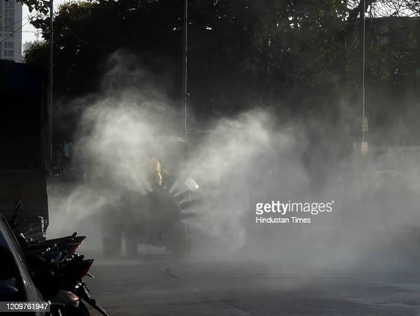 Fire Brigade personnels spray mist of disinfectant to sanitize the area as part of precautionary measures following the rise of COVID 19 patients in...