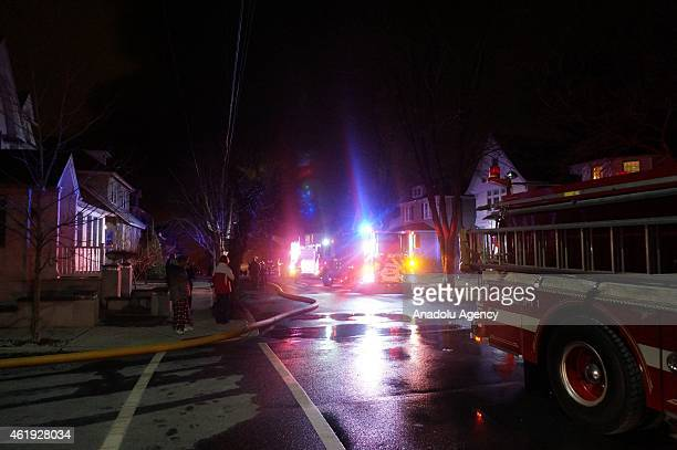 Fire brigade teams are seen after a fire broke out in an apartment complex at Avalon o in Edgewater NJ United States on early evening of January 21...