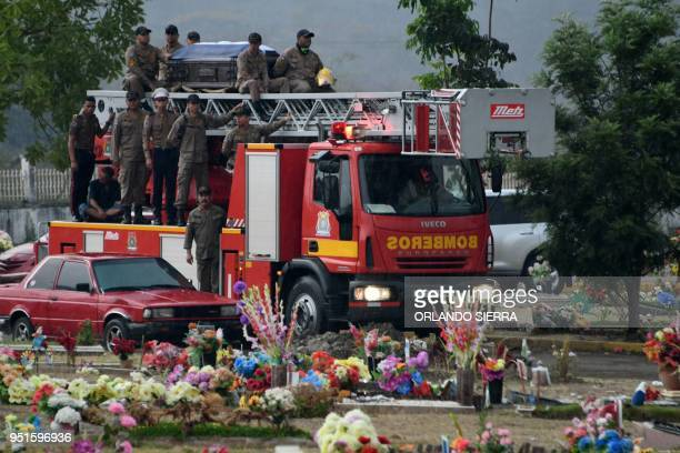 A fire brigade truck carries the coffin of firefighter Josue Vargas who died while trying to extinguish a fire forest in La Montanita at the San...