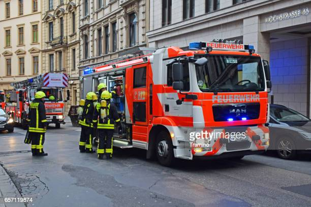 fire brigades in city center - fire station stock photos and pictures