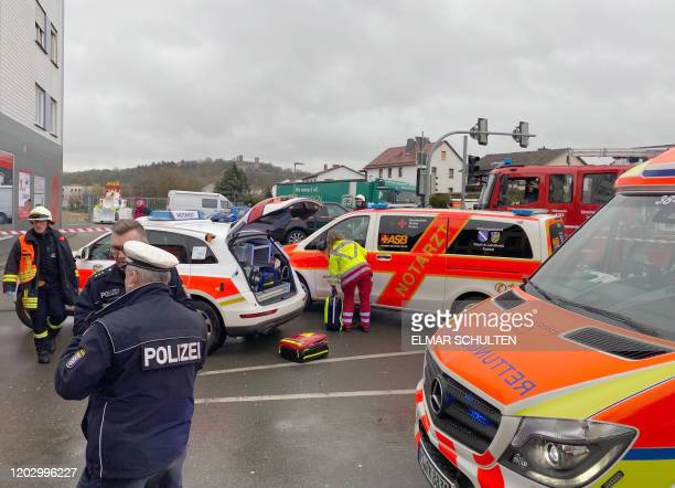 Fire brigades work close to the site where a car drove into a carnival procession in Volkmarsen near Kassel central Germany on Rose Monday February...