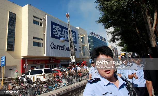 Fire broke out at a Carrefour store in downtown Beijing Wed afternoon 24JUL13 == Photo by Simon Song ==