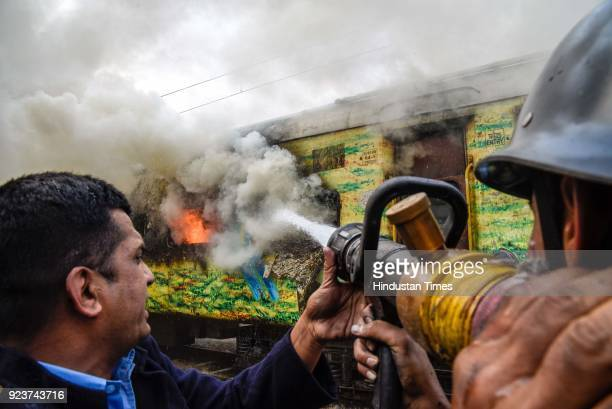 A fire broke out in an empty coach of PuneNew Delhi Duronto Express parked at the yard near Sangam Park on February 23 2018 in Pune India Fire...
