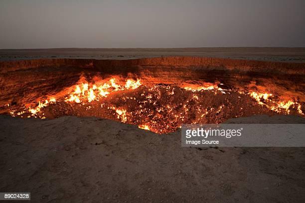 Fire burning in pit in desert