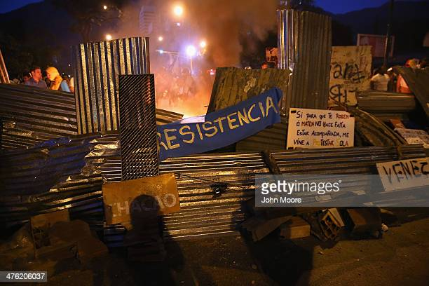 A fire burns behind a barricade during an antigovernment demonstration on March 2 2014 in Caracas Venezuela With one of the highest inflation rates...