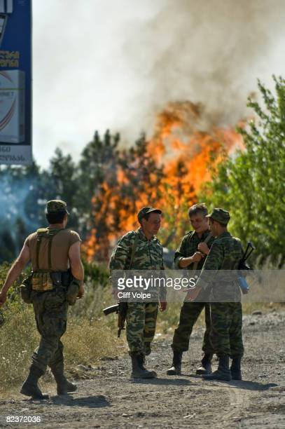 A fire burns behind Russian soldiers at a roadblock August 15 2008 just outside Gori Georgia US Secretary of State Condoleezza Rice arrived in...