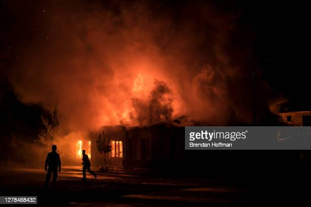 Fire burns in a hardware store after a rocket attack caused the building to catch fire on October 3, 2020 in Stepanakert, Nagorno-Karabakh. A...