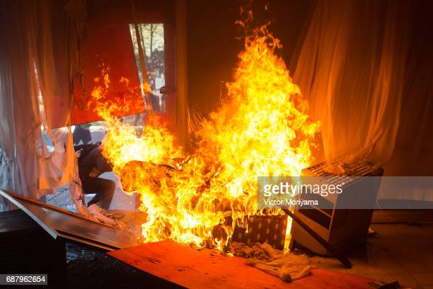 A fire burns in an office inside the Ministry of Agriculture as protesters against President Michel Temer clashed with the police on May 24 2017 in...