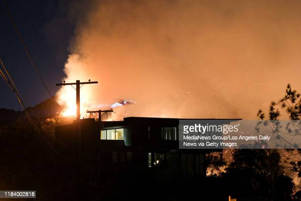 Fire burns in Mandeville Canyon near expensive homes in the Getty fire Monday October 28 2019