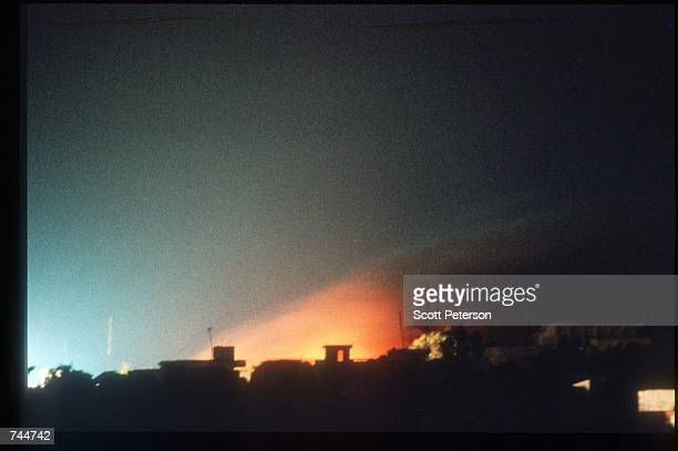 A fire burns in the darkness December 6 1993 in Mogadishu Somalia US gunships attacked the compound of warlord Mohammad Aidid in response to attacks...