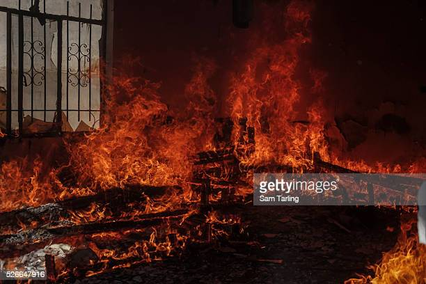 A fire burns in the house that had belonged to an Arab family in the town of Sinjar Iraq on November 15 2015 Sinjar was recaptured from ISIS on...