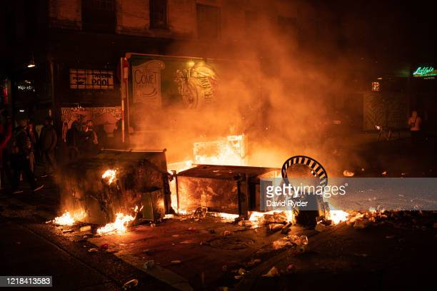 Fire burns in the street after demonstrators clashed with law enforcement near the Seattle Police Departments East Precinct shortly after midnight on...