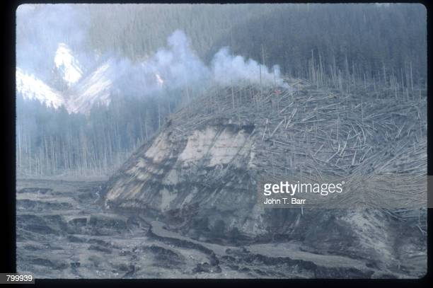 Fire burns May 23, 1980 in Washington State. On May 18 an earthquake caused a landslide on Mount St. Helens'' north face, taking off the top of the...