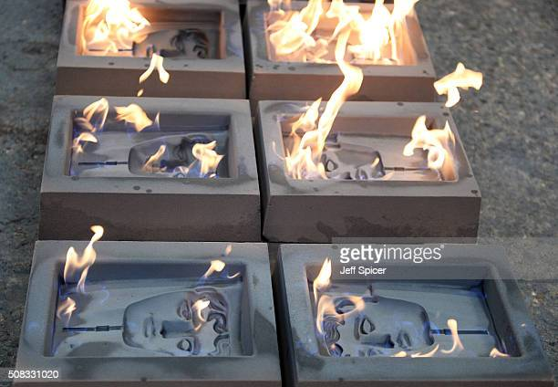 Fire burns on the molds as the iconic bronze masks are cast in to the BAFTA trophy for the 2016 British Academy of Film and Television Arts award...