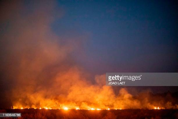 TOPSHOT A fire burns out of control after spreading onto a farm along a highway in Nova Santa Helena municipality in northern Mato Grosso State south...