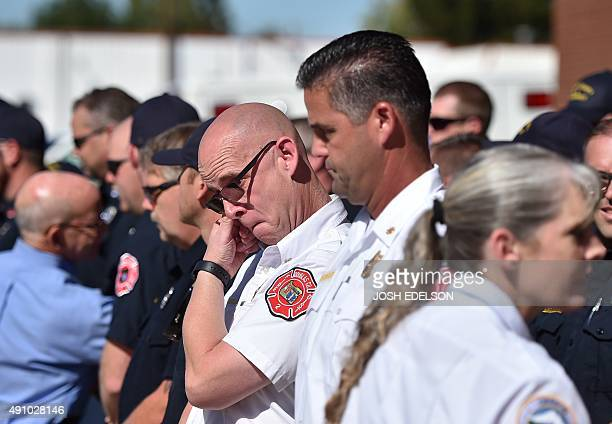 Fire Chief and first responder Greg Marlar reacts after being given a hug by Oregon Governor Kate Brown at the conclusion of a press conference in...