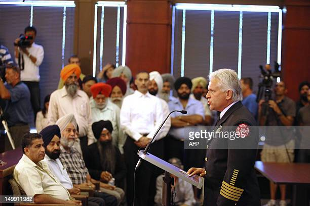 Fire Chief Tom Rosandich speaks at a press conference August 6 2012 in Oak Creek Wisconsin about the shootings Sunday at the Sikh Temple of Wisconsin...