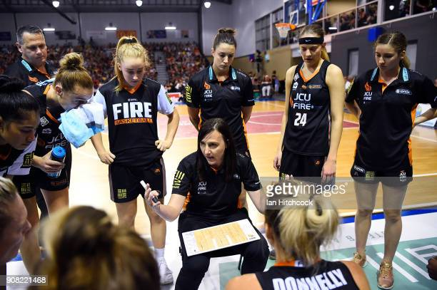 Fire coach Claudia Brassard speaks to her players in a time out during game three of the WNBL Grand Final series between the Townsville Fire and...