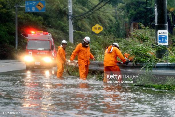 Fire company members check the flooded road on September 16 2019 in Tateyama Chiba Japan Some residents of southern Chiba Prefecture have given up...