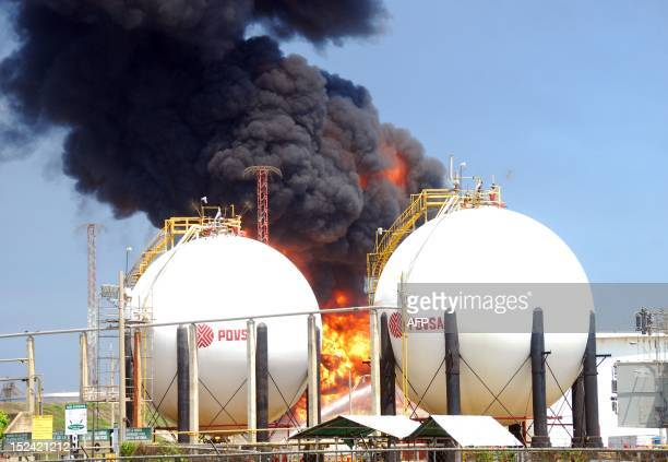 Fire consumes two gasoline storage tanks in the El Palito refinery in Puerto Cabello in the northern state of Carabobo Venezuela on September 20 2012...