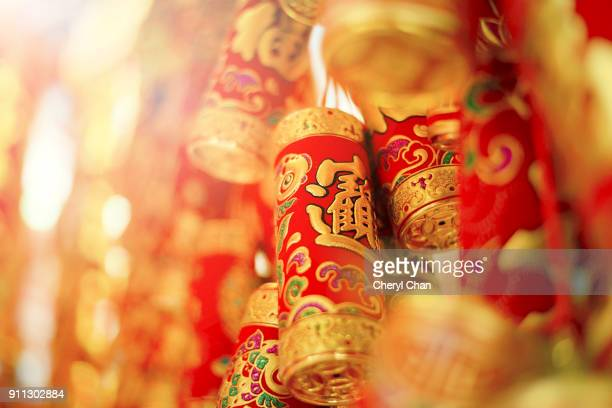fire crackers - chinese new year decoration - chinese new year stock pictures, royalty-free photos & images