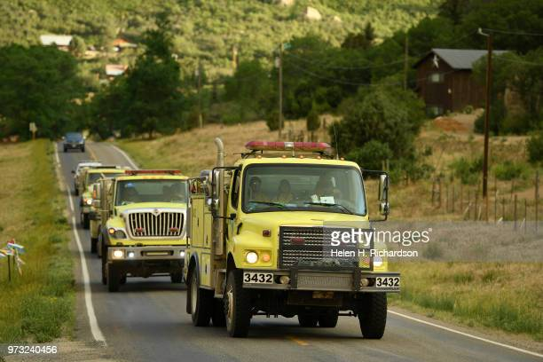 Fire crews arrive for night duty as they head toward the 416 fire along County Road 205 on June 12 2018 in Durango Colorado The fire burning 23 miles...