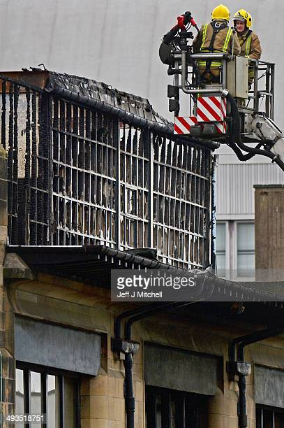 Fire crews continue to attend the Glasgow School of Art Charles Rennie Mackintosh Building following yesterdays fire on May 24 2014 in Glasgow...
