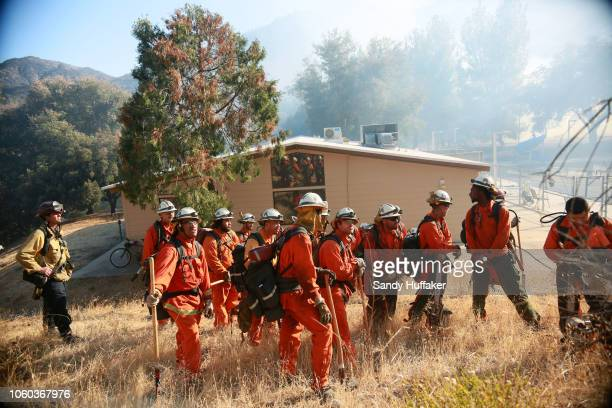 Fire crews prepare to clear brush along a fire line at the Salvation Army Camp on November 10 2018 in Malibu California California The Woolsey fire...
