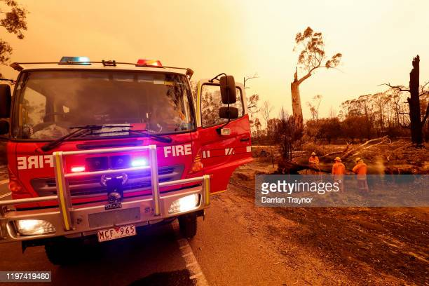 Fire crews put out spot fires on January 04 2020 in Sarsfield Australia Two people are dead and 28 remain missing following bushfires across the East...