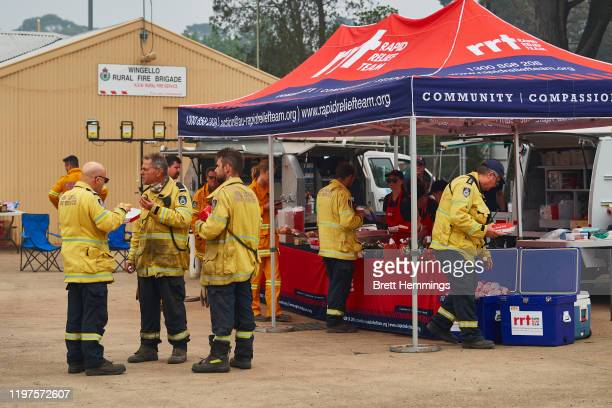 "Fire crews take a break and enjoy food prepared by a ""Rapid Relief Team"" at the Wingello RFS Station on January 5, 2020 in Wingello, Australia. One..."