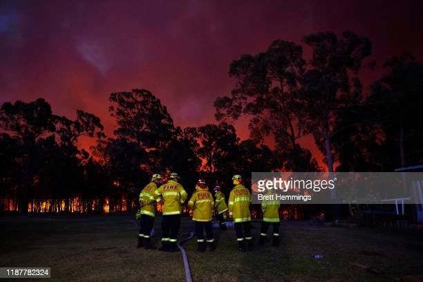 Fire crews wait at a property along Putty road as the fire front approaches on November 15 2019 in Colo Heights Australia The warning has been issued...