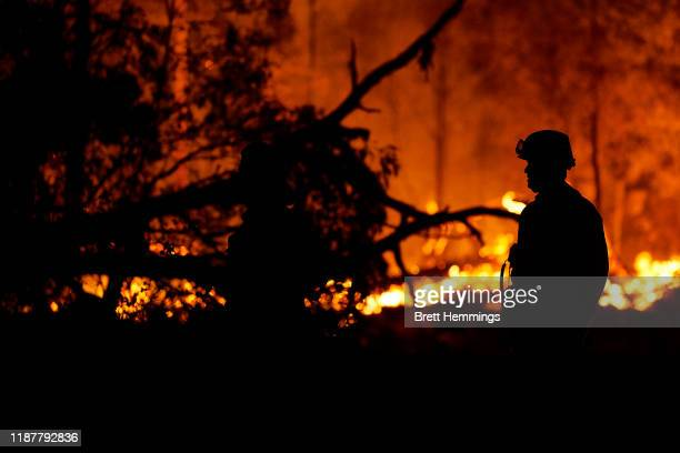 Fire crews wait on a property along Putty road as the fire front approaches on November 15 2019 in Colo Heights Australia The warning has been issued...