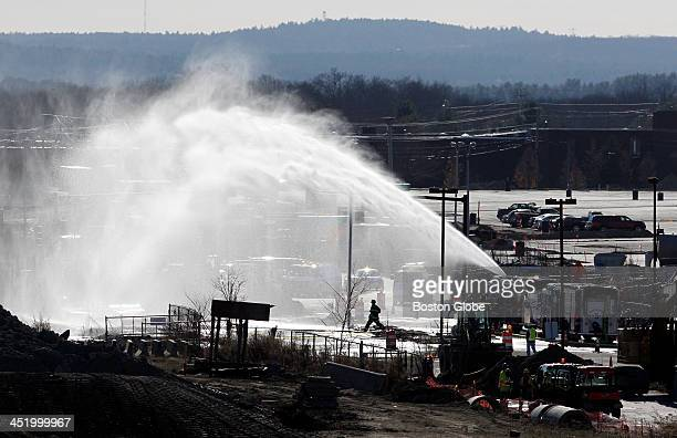 Fire crews work on a gas leak near the Amtrak T station on University Avenue in Westwood Mass on November 21 2013