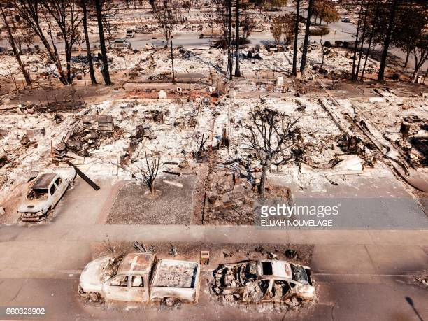 TOPSHOT Fire damage is seen from the air in the Coffey Park neighborhood October 11 in Santa Rosa California More than 200 fire engines and...