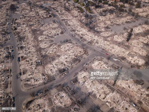 Fire damage is seen from the air in the Coffey Park neighborhood on October 11 in Santa Rosa California More than 200 fire engines and firefighting...