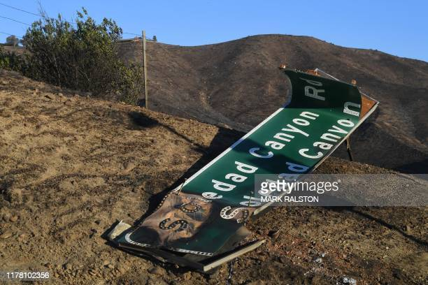TOPSHOT Fire damage to the Highway 14 during the Tick Fire in Agua Dulce near Santa Clarita California on October 25 2019 California firefighters...