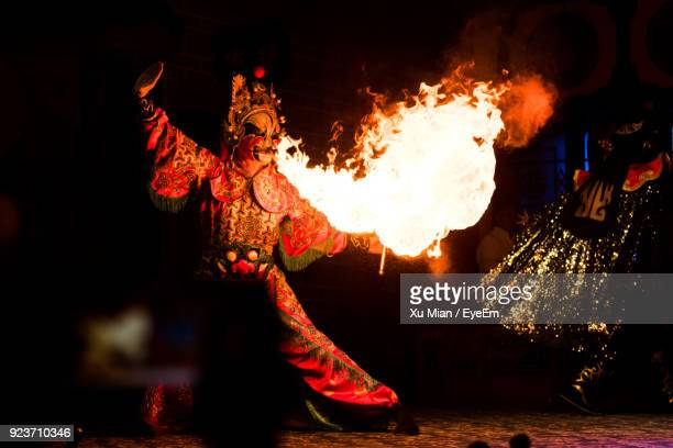 fire dancer on field at night - in flames i the mask stock pictures, royalty-free photos & images